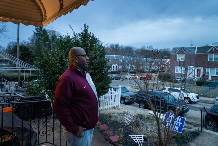 """Marc Reason, president of the Overbrook Park Civic Association, shown on the front porch of his home Friday, March 15, 2019, says the community is """"extremely concerned"""" about an uptick in violent crime."""