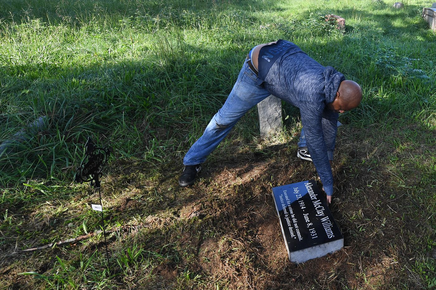 Finally, a headstone for a restless soul executed for a murder no one believes he committed