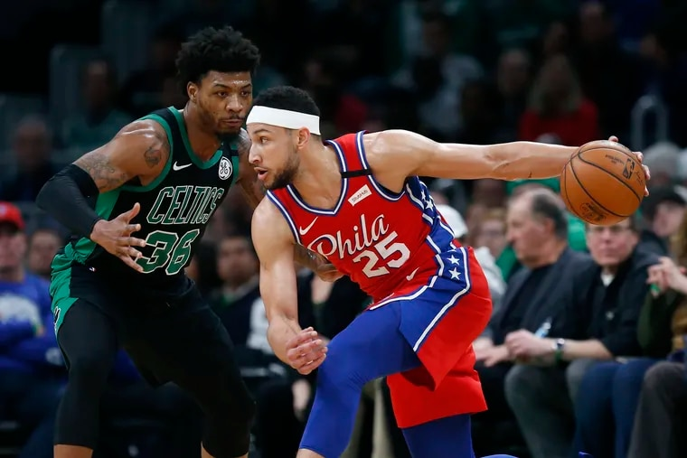 Ben Simmons (25) looks to move against Boston Celtics' Marcus Smart (36) during the first half.