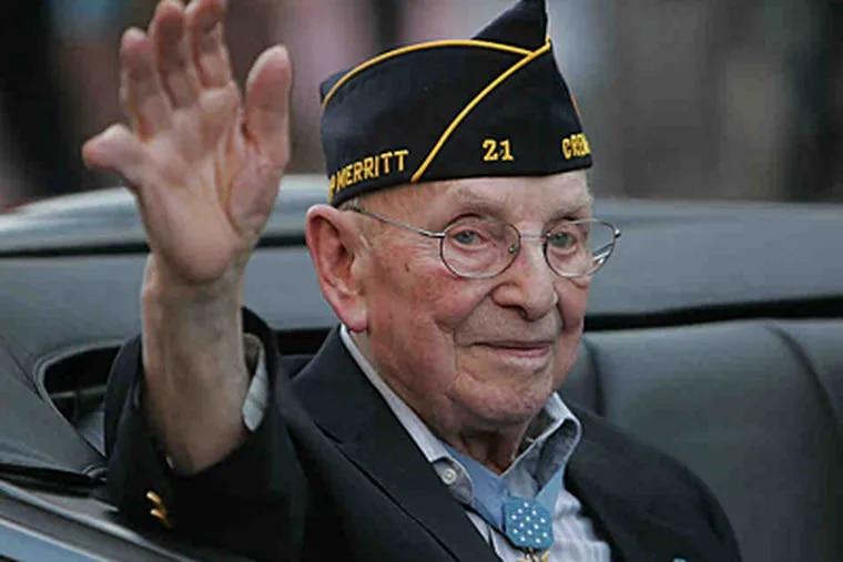 Then 93, Nicholas Oresko waves during last year's Memorial Day parade in Hoboken, N.J. (David Jolkovski / Jersey Journal)