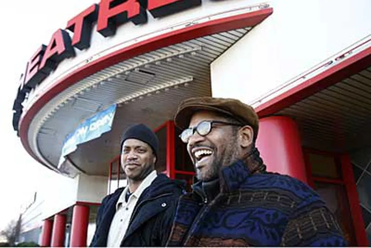 Oladele Barr (left) and Kevin Mitchell stand outside Loews Cherry Hill before going in to see a movie. (Eric Mencher / Staff Photographer)