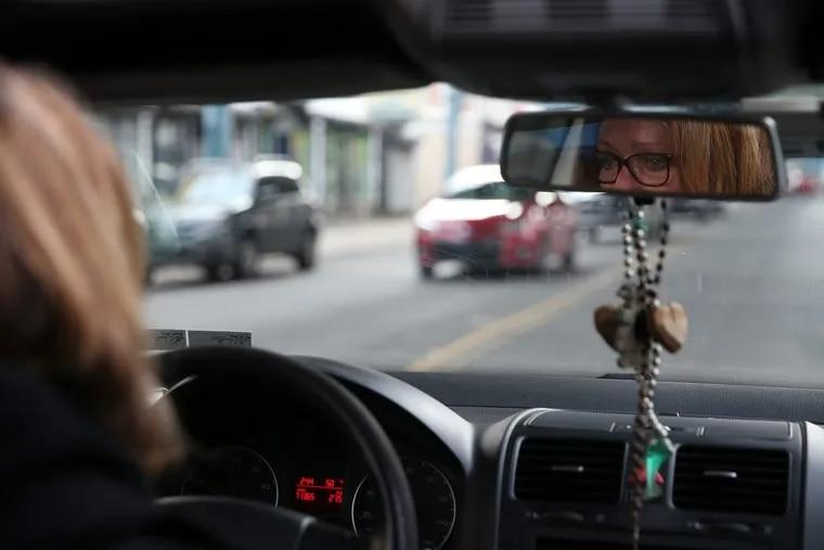 Sandra Steinmetz cries as she drives along Kensington Avenue as she searches for her son, Aaron, in the Kensington neighborhood.