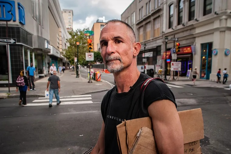Willie Baronet, a Texas-based artist, buys handmade signs asking for help from homeless people and converts them into large works of art that call attention to housing issues in the United States. He is visting 25 cities across the country for his project, which is being documented by a film crew. July 28, 2014, Philadelphia, Pennsylvania. ( MATTHEW HALL / Staff Photographer )