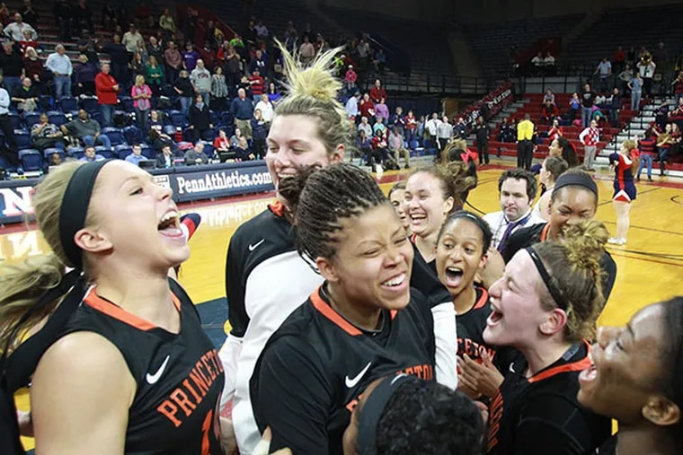 The Princeton women's basketball team completed a perfect 30-0 regular season with a 55-42 victory over Penn on March 10, 2015. Amanda Bernstein, left, Mariah Smith, center, and others celebrate after the game. (Charles Fox/Staff Photographer)