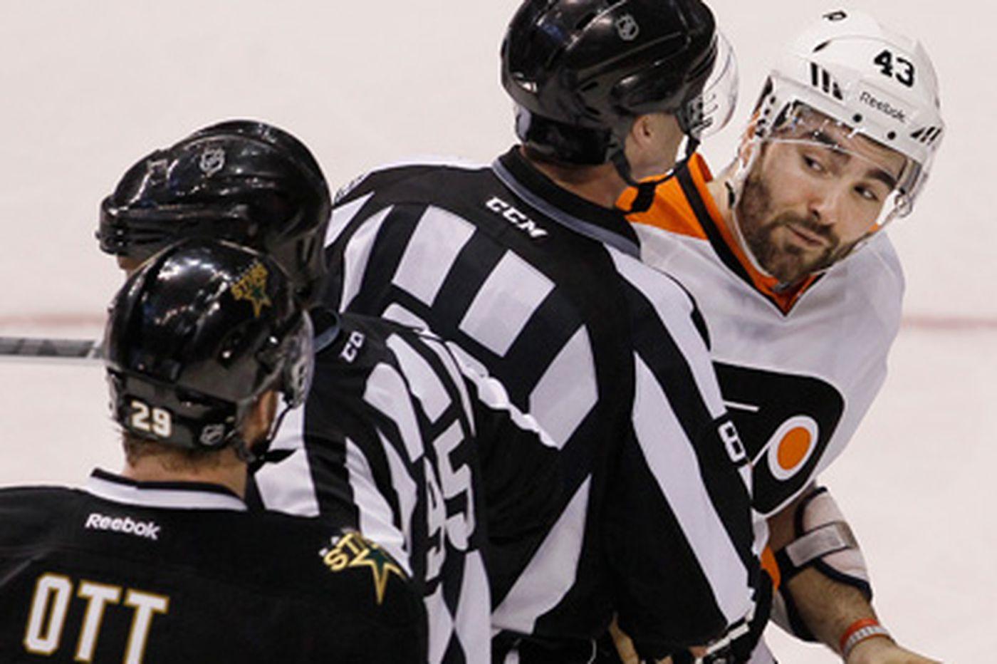 A chip shot between Flyers' Laviolette, Dallas' Ott