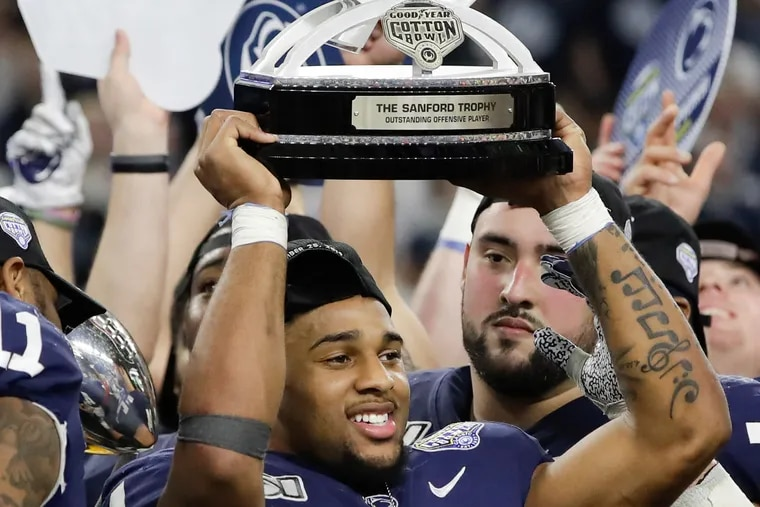 Penn State running back Journey Brown raised the Cotton Bowl outstanding offensive player trophy after Penn State beat Memphis, 53-39, on Dec. 28 in Arlington, Texas.