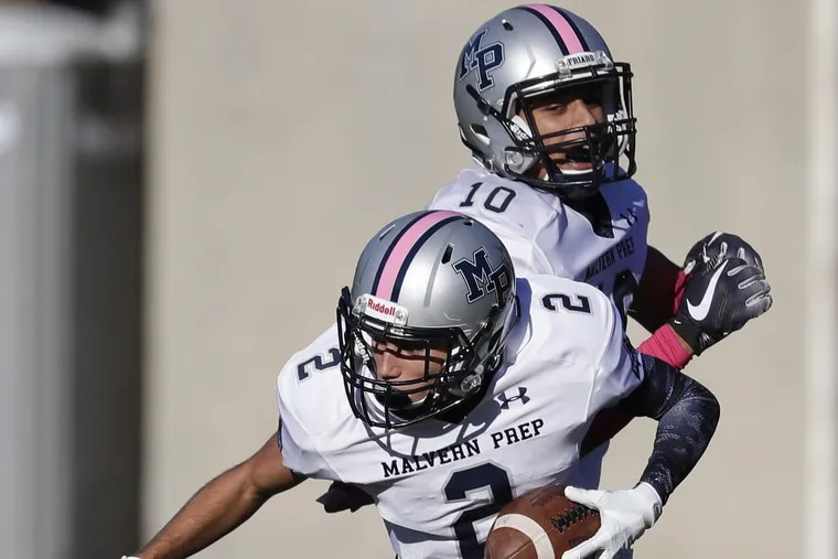 Malvern Prep's Tyler Tinson (front) celebrates his second-quarter touchdown reception against Penn Charter with teammate Lonnie White. The Friars won, 51-17.