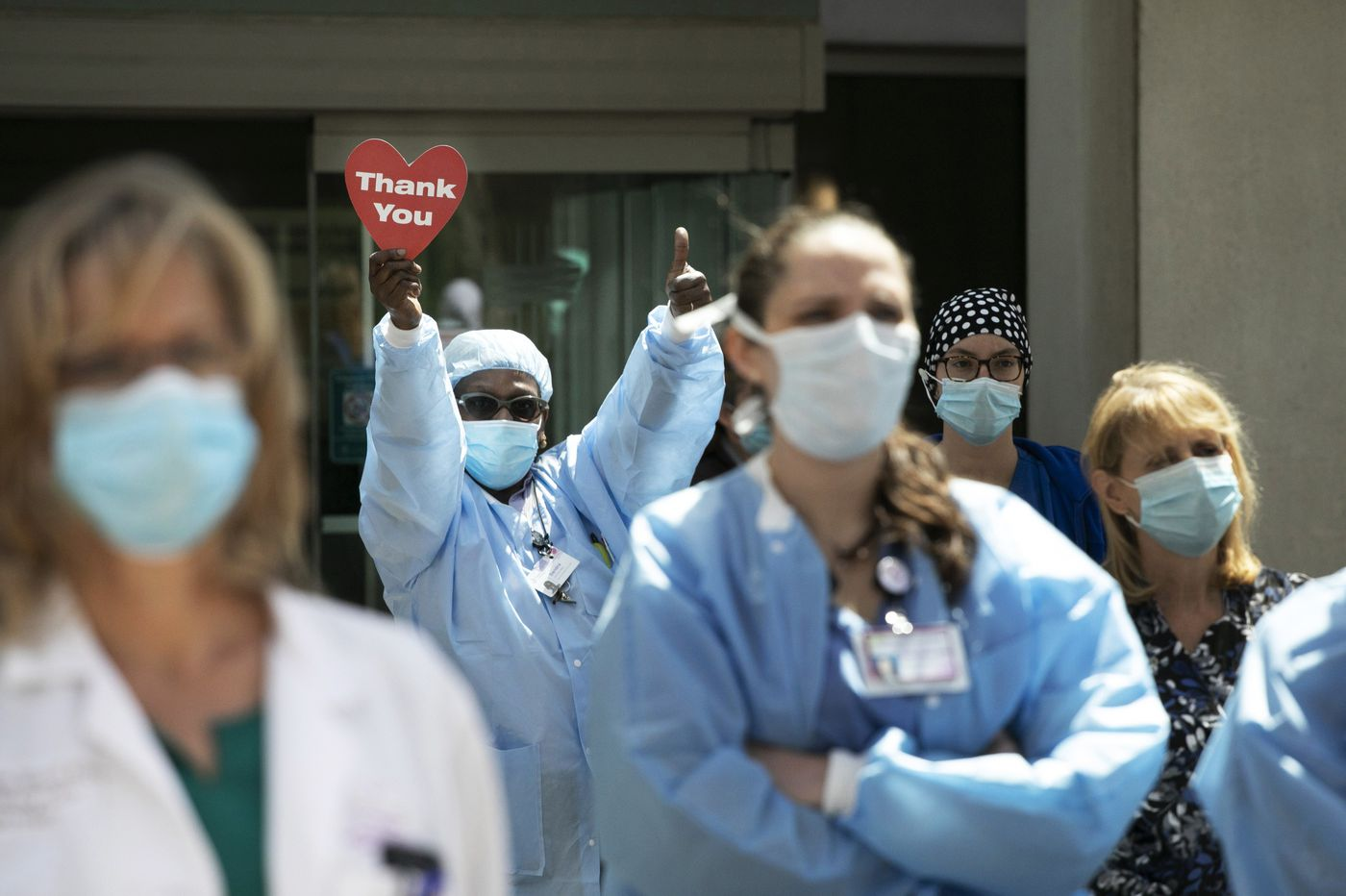 Families of health workers killed by COVID-19 fight for denied workers' comp benefits
