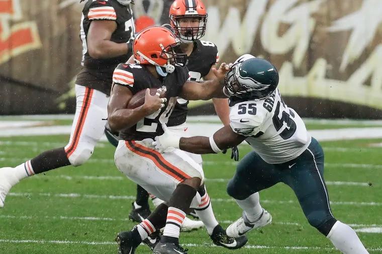 Browns RB Nick Chubb shoves away Eagles DE Brandon Graham during the third quarter of Sunday's 22-17 win.