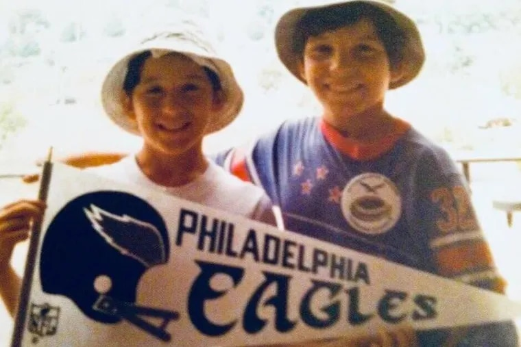 The author's brothers, Teddy and Jon Flowers, at an Eagles game many years ago.