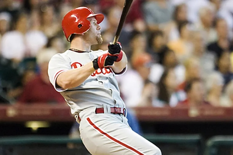 Geoff Jenkins contributed two RBI, including this home run, to the Phillies' 15-6 win over the Astros. (Bob Levey/AP)