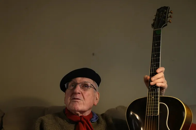 Marty Grosz, legendary Philly jazz guitarist, talks about his music career as he holds his vintage Gibson guitar at his home in Philadelphia, PA on February 26, 2020. Grosz, 89, says he plays every day.