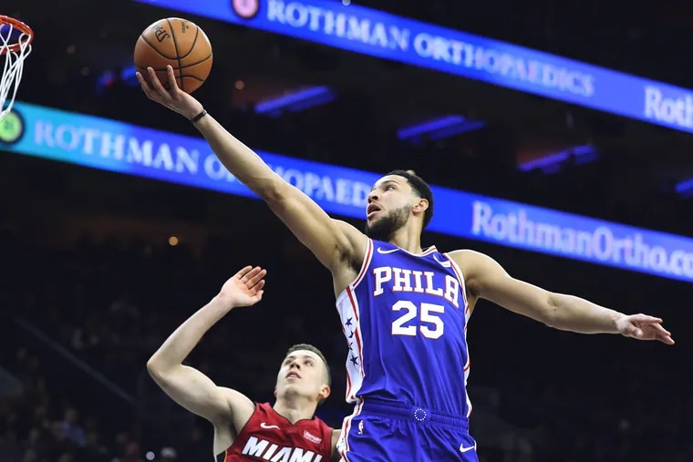 Ben Simmons goes up for a shot against Duncan Robinson of the Heat.