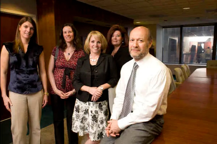 At APF Properties headquarters at 1601 Market St. , Berndt Perl (right) owner, with members of his Philadelphia design team (from left) Claire Belford, Jessica Kavanagh, Missy Quinn, and Theresa McCaul-Mullan.