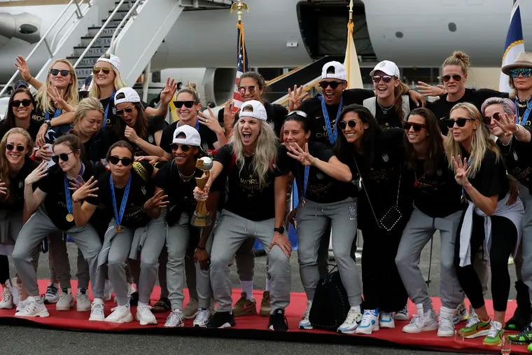 The World Cup champions celebrate after arriving at Newark Airport on Monday.