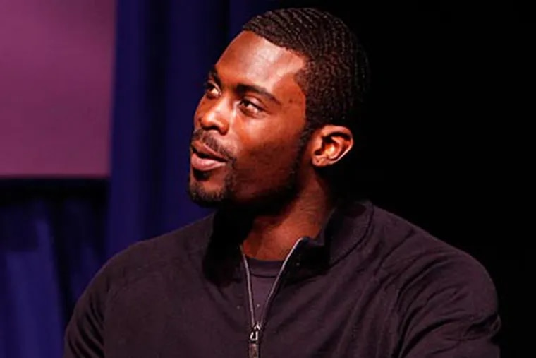 """""""Be a mentor. Don't be a statistic, please,"""" Michael Vick told students at Martin Luther King High. (Laurence Kesterson/Staff file photo)"""