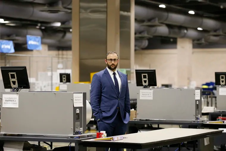 Seth Bluestein, deputy commissioner for City Commissioner Al Schmidt, on Monday inside the ballot counting room at the Pennsylvania Convention Center in Philadelphia. Bluestein has been the target of anti-Semitic abuse and threats after former Florida Attorney General Pam Bondi named him at a Trump campaign press conference.