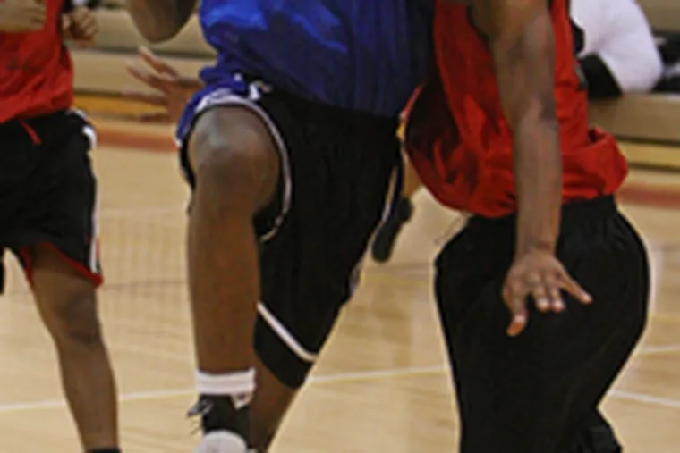Salem's Quayshawn Morris drives the lane against Kingsway during a scrimmage. Salem, paced by junior center Derrick Parsley, is predicted to win the Classic Division this season.