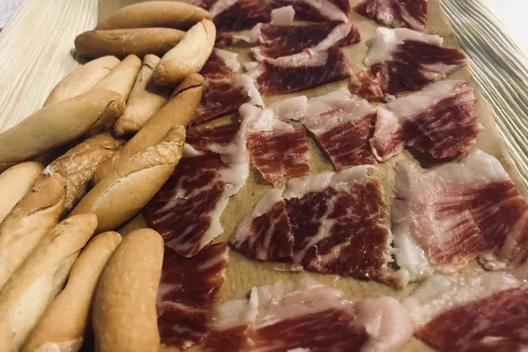 Iberian ham from Taste of Spain in Reading Terminal Market. The pigs that produce this ham are fed on acorns, giving the meat a rich, nutty flavor.