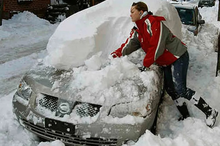 Remember this? Merissa Robitaille digs out her car after the December dumping. Looks like another big storm is on its way. (Michael S. Wirtz / Staff Photographer)