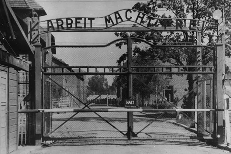 This undated file image shows the main gate of the Nazi concentration camp Auschwitz I in Poland, which was liberated by the Russians in January 1945. (AP Photo/File)