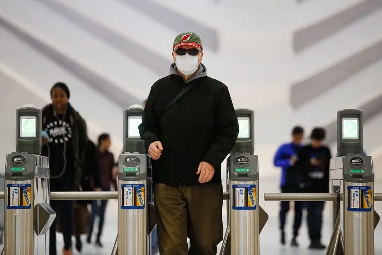 A commuter wears a face mask in the New York City transit system.