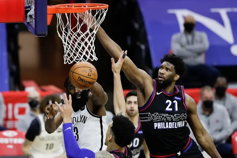 Joel Embiid, right, had 33 points, nine rebounds, three assists and two steals in the Sixers' win over the Nets.