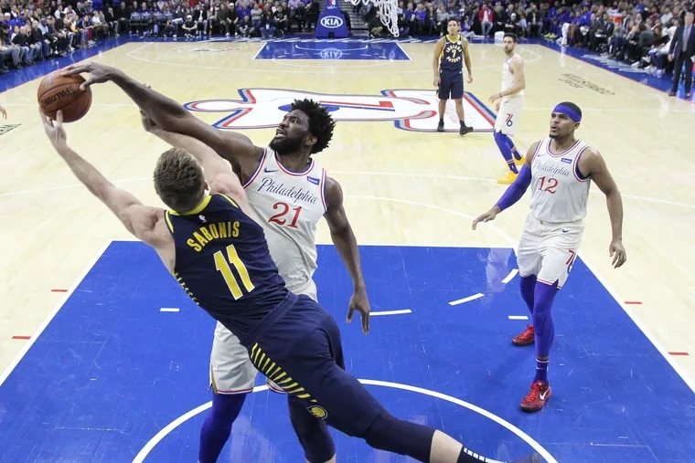 Domantas Sabonis, left, of the Indiana Pacers has his shot blocked by Joel Embiid in the first half at the Wells Fargo Center on Sunday.