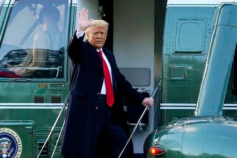 Outgoing President Donald Trump waves as he boards Marine One on Jan. 20 on the South Lawn of the White House, en route to his Mar-a-Lago Florida Resort on the last day of his term.