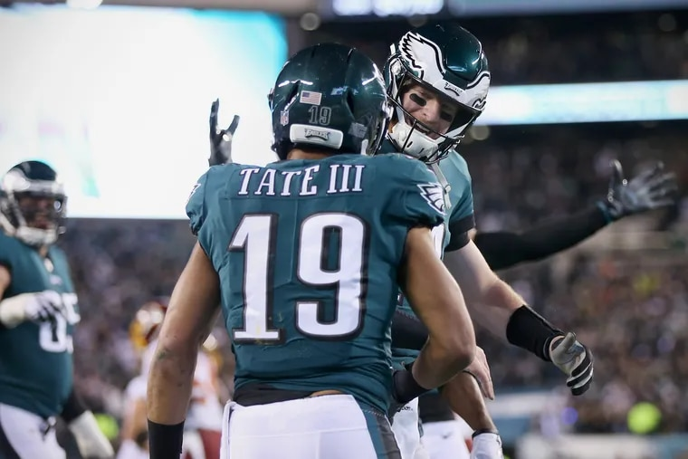 Eagles wide receiver Golden Tate (19) celebrates his first-quarter touchdown reception with quarterback Carson Wentz (11) during a game against the Washington Redskins at Lincoln Financial Field in South Philadelphia on Monday, Dec. 3, 2018. The Eagles won 28-13.