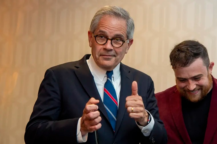 District Attorney Larry Krasner leaves the stage after his victory speech following the Democratic primary election on May 18. His son, Nate, is standing beside him.