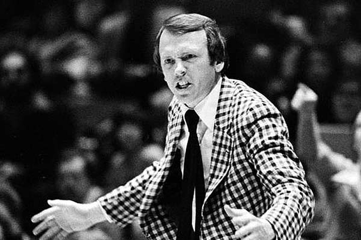 Hiring Billy Cunningham as head coach of the Sixers