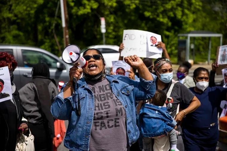 Quanda Guyton, 41, of Northeast Philadelphia, speaks in front of fellow activists gathered to protest outside of the Curran-Fromhold Correctional Facility on April 30.