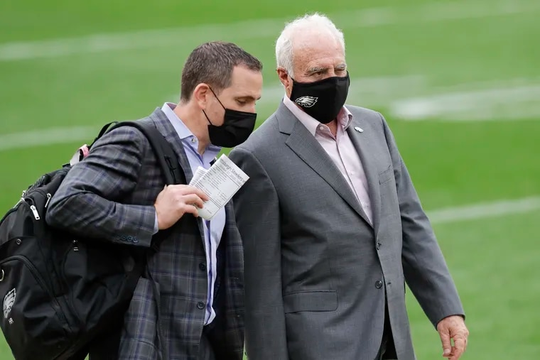 Eagles owner Jeffrey Lurie (right) is not considering firing general manager Howie Roseman (left).