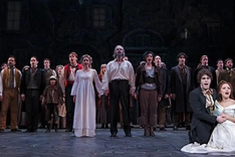 """Company of """"Les Misérables"""" at the Walnut Street Theatre. """"The thing I wanted to do was to rediscover the heart of 'Les Miz,' director Mark Clements said. He worked with a cast of 36, including many local actors."""