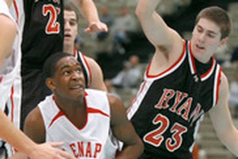 Lenape's Isiah Dixon eyes the basket as he drives past Ryan defenders Tom Marshall (left) and Anthony Keiter.