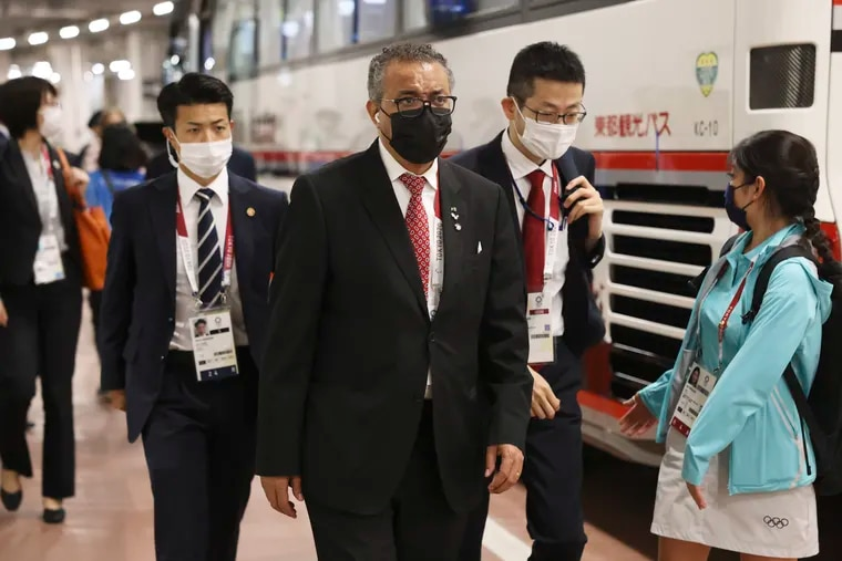World Health Organization Director-General Tedros Adhanom Ghebreyesus, arriving at the opening ceremony for the Olympic Games on July 23, 2021, in Tokyo, Japan, has asked China to comply with further investigation into COVID-19's origins.