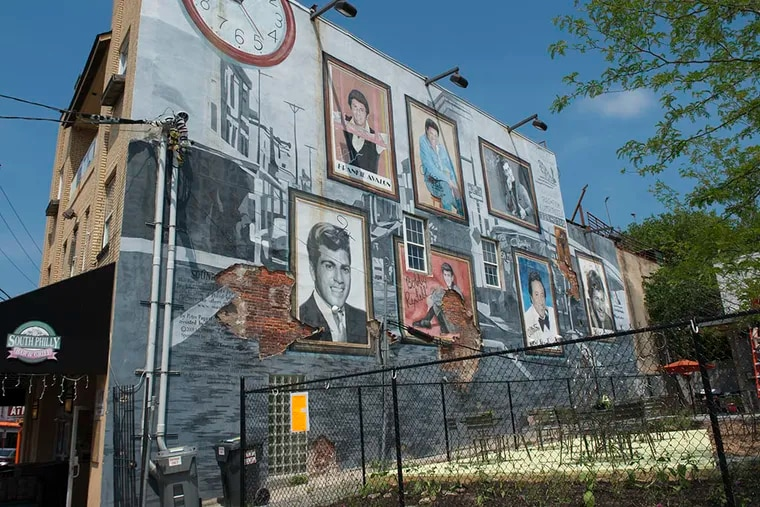 The mural, near Pat's King of Steaks at Ninth Street and Passyunk Avenue, will come down, but it might be replaced elsewhere with the same images of homegrown stars. (MICHAEL PRONZATO/Staff Photographer)