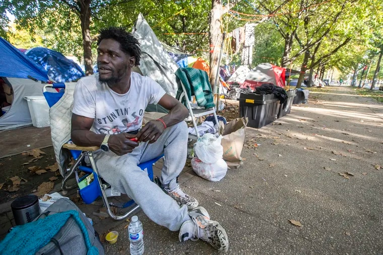 """Ty-san Bostick has been at the encampment on the Benjamin Franklin Parkway for about a month.  The city and encampment organizers reached an """"unprecedented"""" agreement that will close the encampment by the end of the week."""