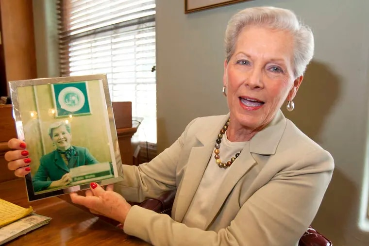 """Letitia """"Tish"""" Colombi, Haddonfield commissioner and mayor, holds a photo from her first day in office."""
