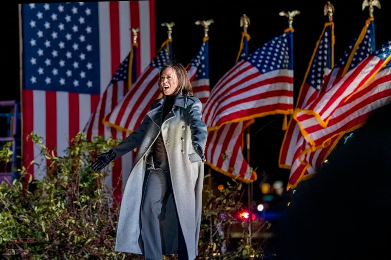 Democratic vice presidential nominee Kamala Harris arrives on stage for an election eve drive-in rally outside the Phillies' Citizens Bank Park Nov. 2, 2020.