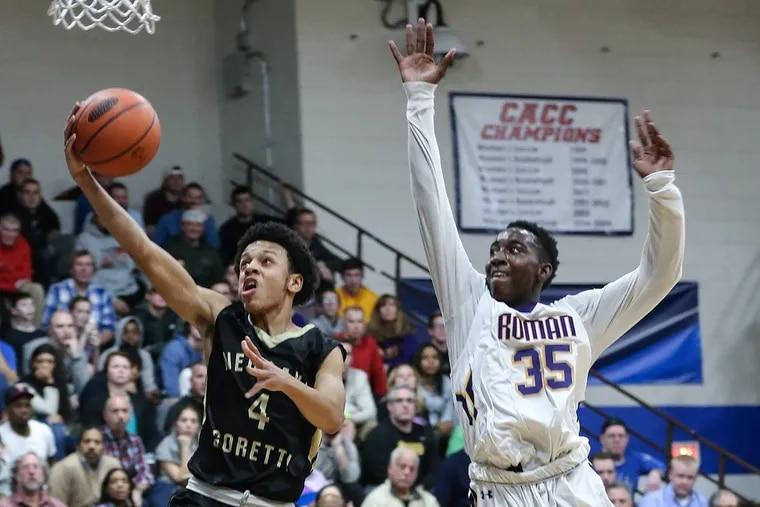 Neumann-Goretti's Noah Warren (4) drives to the basket in a Catholic League game last season against Roman Catholic.