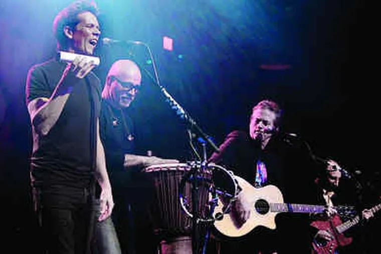 ACTOR KEVIN Bacon (left) and his brother, Michael (with guitar), sing at the Electric Factory on Saturday night, at a show to raise money for the Mummers Parade.