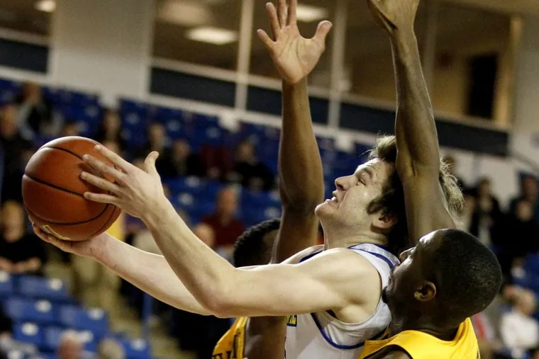 Archbishop Carroll grad Ryan Daly is having a good freshman year playing for Carroll grad Martin Inglesby at Delaware. He goes up for a shot through mulitple Drexel defenders on Feb. 16, 2017. CHARLES FOX / Staff Photographer