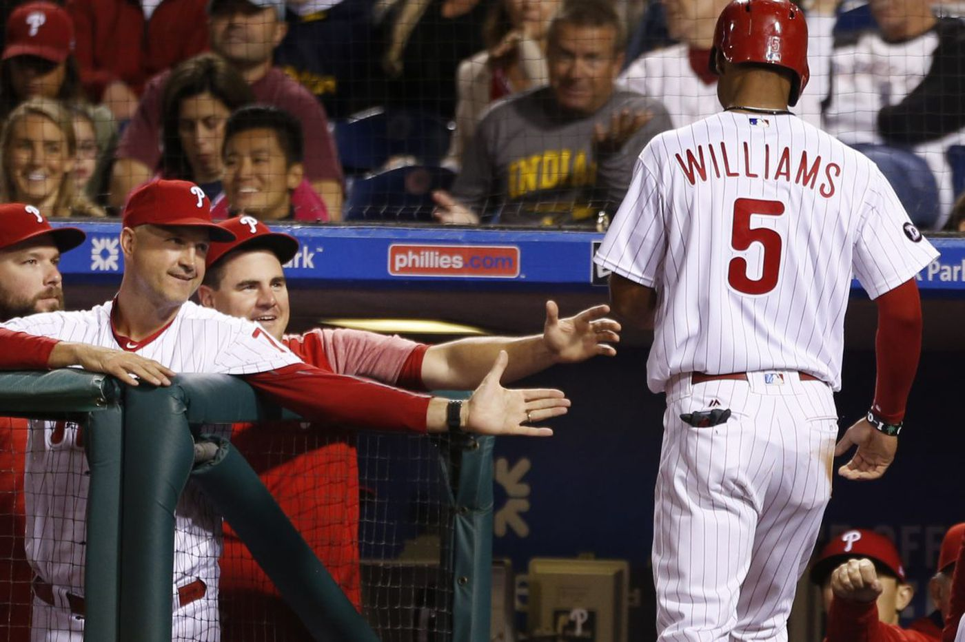 Phillies use trio of home runs to beat Mets to cap strange day