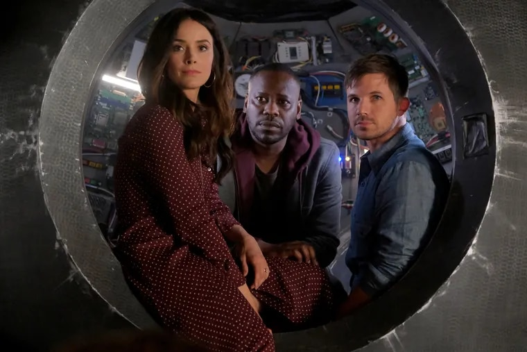 """""""Timeless"""" stars Abigail Spencer, Malcolm Barrett (center) and Matt Lanter. The time-travel series will end with a two-hour finale, """"The Miracle of Christmas,"""" on Thursday, Dec. 20."""