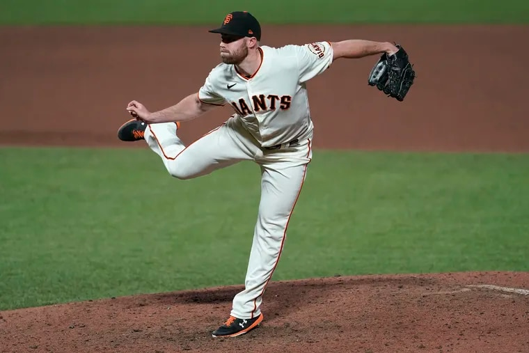 Sam Coonrod pitching for the Giants last September.