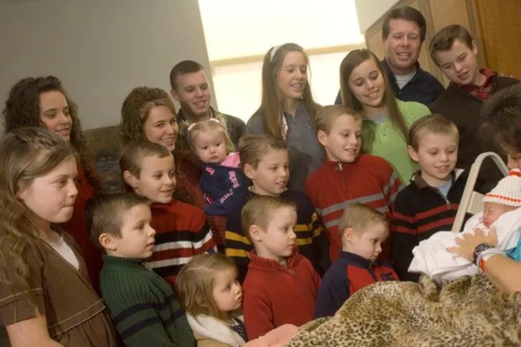 """Michelle Duggar with her newborn. (""""17 kids +1 = migraine!"""")"""