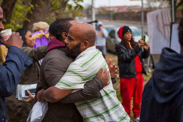 Supporters and recently released individuals embrace during a November 2018 Philadelphia Community Bail Fund bail-out.