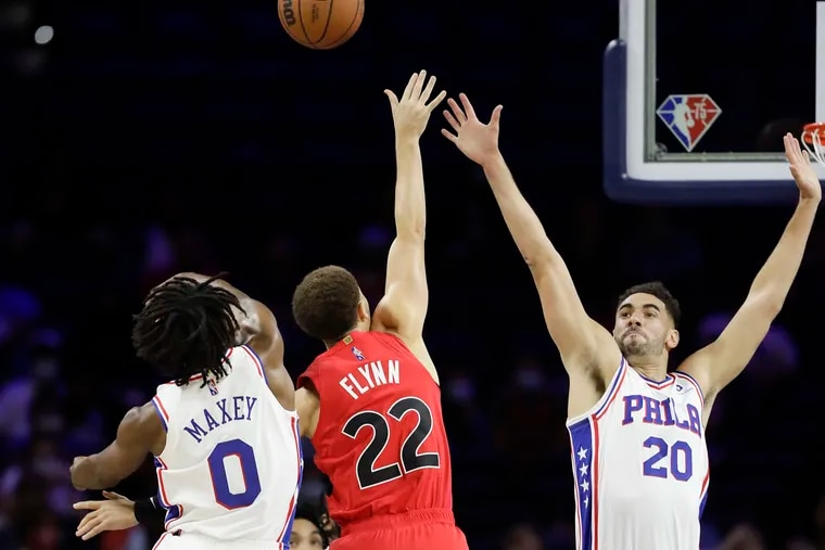 Sixers guard Tyrese Maxey and forward Georges Niang defend the Toronto Raptors' Malachi Flynn during a preseason game last week.